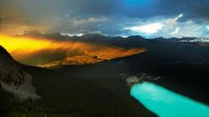 Banff National Park  Colours compete as the setting sun sinks over the mountains behind the emerald waters of Lake Louise. (Mark Read)