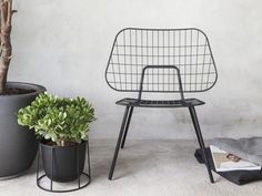 The WM String Lounge Chair designed by StudioWM is minimal, light and airy.