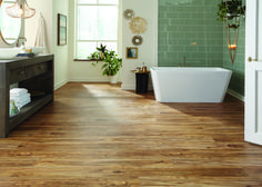 These durable luxury vinyl flooring planks are waterproof (great for bathrooms, kitchens, and
