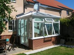 White PVCu DIY Edwardian Glass-Roof Conservatory. Manufactured and supplied by ConservatoryLand DIY Conservatories.