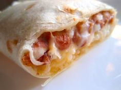 Freezer friendly burritos filled with chicken, rice, and cheese