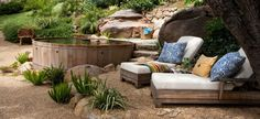 Love the tank pool, needs a small waterfall over large river rocks, shade, wood decking surrounding part with remaining surrounded by river rock planted sporadically with succulants, privacy fencing maybe <3