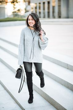 Grey Bell sleeve top and black boots