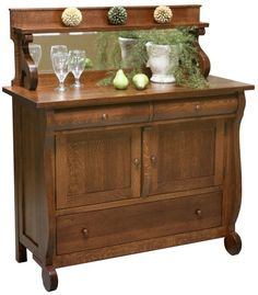 Provincial styling lets our handmade Bobois French Country Sideboard make a statement in mortise and tenon joined solid wood with a mirrored backsplash.