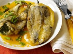 Chiles Rellenos in Tomato Broth: Deep-fried poblano chiles are stuffed with Muenster cheese then set in a savory tomato broth.
