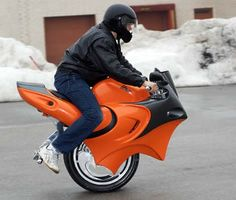 """This wild new motorcycle, invented by 19-year-old Ben J. Poss Gulak. Debuting at the National Motorcycle Show in Toronto, the """"Uno"""" uses gyro-technology for balance and acceleration. It is a battery charged machine that accelerates by leaning forward and slowing down by leaning backwards.It weighs approximately 129 pounds (58 kg.) and has a top speed of 25 mph (40 klms)."""