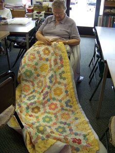 Love the scrappiness hexie grandmother's garden quilt