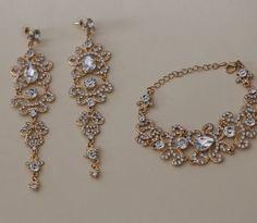Long bridal earrings , gold jewerly, gold bridal jewerly, gold wedding jewerly , gold earrings, gold bridal earrings, gold wedding earrings, gold bridal bracelet, gold wedding bracelet, gold bracelet, bracelet, earrings, wedding earrings , bridal earrings, bridal jewelry , wedding jewelry , crystal earrings, long earrings , chandelier earrings , bridesmaid earrings , rhinestone earrings , pearl earrings , cubic zirconia , teardrop earrings , cz earrings , gatsby earrings, 1920s