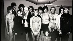 Warhol Factory: Gino P?, Paul Morrisey, Geraldine Smith, ?, Candy Darling, ?, Eric Emerson (center), Gerard Malanga, Bridget Berlin, Taylor Mead, Joe Dallesandro, Andy Warhol & Ultra Violet (seated).