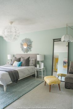 Shades of mint mix with citrus accents to create a cool, refreshing bedroom retreat.