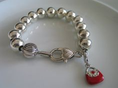 Classic bracelet of silver toned beads on silver by LeeliaDesigns