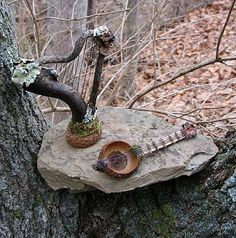 fairy harp and guitar made from twigs and acorn caps