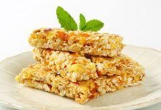 Perfect for breakfast on-the-go or a quick snack, these moist and chewy granola bars can be customized with any combination of nuts, seeds and dried fruit. Healthy Bars, Healthy Breakfast Recipes, Healthy Foods, Chewy Granola Bars, Breakfast On The Go, Foods To Avoid, Quick Snacks, Tray Bakes, Vegan Recipes