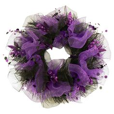 Wrapped in black and purple tulle, this Halloween wreath gives your guests a festive greeting.  Product: WreathConstructi...