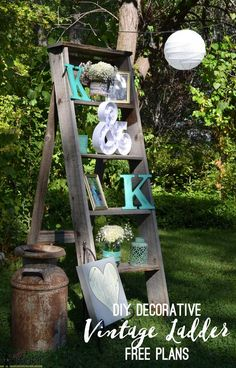 Free plans to build a DIY decorative vintage wood ladder. This vintage inspired ladder makes a unique display for weddings and home decor. Plus a few other ideas for DIY rustic wedding decor.