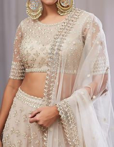 Apr 2020 - Ivory lehenga with silver zardozi hand work hindu wedding Indian Fashion Dresses, Dress Indian Style, Indian Designer Outfits, Designer Dresses, Fashion Blouses, Lehenga Designs, Saree Blouse Designs, Dress Designs, Indian Wedding Outfits