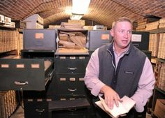 Northumberland County Prothonotary Justin Dunkleberger talks about the process of backing up the old files of his office that are stored in the basement of the county courthouse in Sunbury on Monday morning.