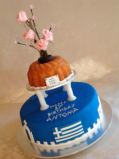 My big fat Greek 21st.. Vanilla cake layered with smooth buttercream & covered in fondant. Hand cut gum paste Greek flag & side scenes. Vanilla bundt cake stacked on Grecian pillars.