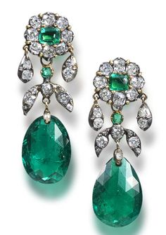 A pair of emerald and diamond pendent earrings  Each step-cut emerald and old brilliant-cut diamond floral cluster surmount, suspending similarly set foliate connecting links, terminating in an emerald briolette drop, diamonds approximately 2.30 carats total, composite, length 4.0cm. Victorian or Victorian style.