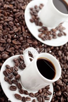 coffee cup with coffee beans - Cup of coffee with coffee beans in abundance