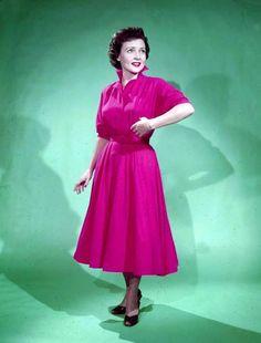 Betty White looking lovely in an eye-catching fuchsia dress.