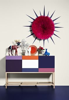 Juju Hat Our Magenta Bamileke Feather Headdress, Orange Wired Lace Bowl & Blue Bead Vases as featured by Dulux for the L'Oreal Melbourne Fashion Festival via thedesignfiles.net