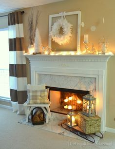 White Winter Mantel with neutrals: white, silver, and naturals.  Pillows are DIY from a sweater and a placemat.
