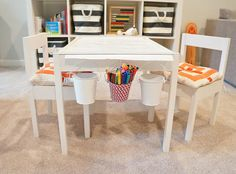 Quinn's play space - love the buckets hanging off the table! via freckles chick