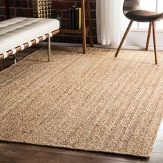 Bring an organic element into your living space with this natural fiber jute rug from nuLOOM. The beige and light brown Alexa Eco rug features natural color variations to add a relaxed feel to your ho