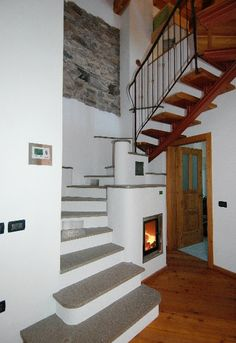 Staircase behind the fireplace / masonry stove