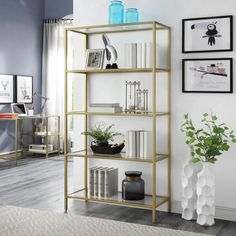 Brighten up your storage space with a classic and modern style with the help of this Carolina Cottage Marcello Gold Glass Shelf Bookcase. Gold Bookshelf, Glass Bookcase, Open Bookcase, Etagere Bookcase, Salon Shelves, Bookcase Styling, Tempered Glass Shelves, Florida Living, Nebraska Furniture Mart