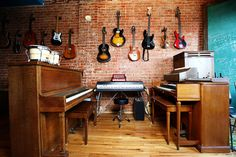 Would love to have a real music room, at least for DF's 7 guitars. Love how they are displayed on the wall. Added bonus- kids can't reach them, but DF still can play!
