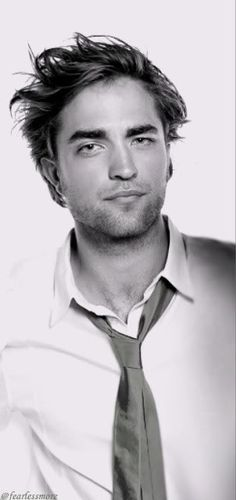 tousled hair, minimal scruff, silk tie, white shirt with the top button undone.... Yes please!