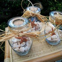 I can use my old candle jars for this! Centerpieces beach theme