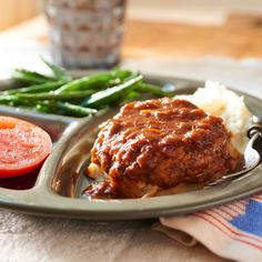 We used a blend of two kinds of ground meats for the patties. The turkey breast brings the total fat down while the ground round adds moistness and flavor. Serve with roasted vegetables, such as potatoes and carrots.