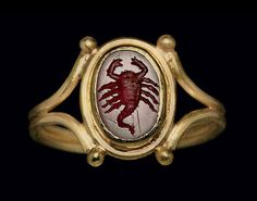 century AD roman signet ring with an intaglio carnelian depicting a scorpion Bracelet Antique, Antique Rings, Antique Gold, Antique Jewelry, Vintage Jewelry, Renaissance Jewelry, Ancient Jewelry, Viking Jewelry, Roman Jewelry