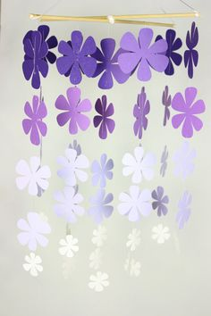 Fading Flower Whimsy Mobile. Easy enough to create - would be a great way to define a space as a party deco.
