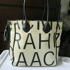 Selling white and black canvas Isaac mizrahi tote Hello selling white and black canvas Isaac mizrahi tote bag.  Large and roomy. I just don't carry it anymore. Few little spots but in excellent condition. Isaac Mizrahi Bags Totes