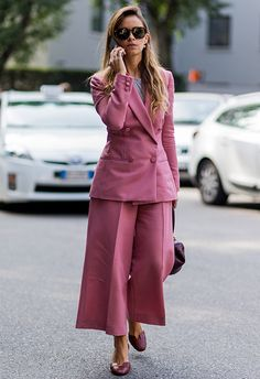 Miroslava Duma street style from fashion week wearing pink suit