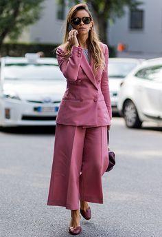 Miroslava Duma street style from fashion week wearing pink suit