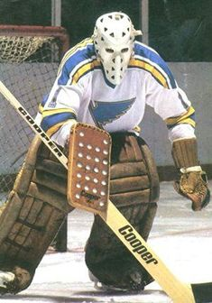 Originally drafted by the Blues, Mike Liut would opt to join the WHA instead. When the WHA merged with the NHL, the Blues would reclaim Liut's rights. Hockey Goalie Gear, Ice Hockey Teams, Hockey Stuff, Hockey Sweater, Blues Nhl, Goalie Mask, St Louis Blues, Masked Man, Go Blue