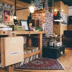 WUNDRBAR vintage shop design with old bench, carpets, industrial light, and more vintage items.