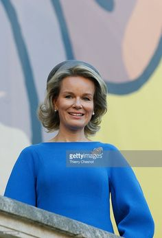 Queen Mathilde of Belgium poses for photos in front of a giant poster of comic character Tintin on October 5, 2016 in Paris, France. Queen Mathilde visits the 'HERGE' exhibition at the Grand Palais.  (Photo by Thierry Chesnot/Getty Images)