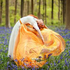 Flaming dance in the bluebell woods Model - Natalie Gray H&MUA Marie Kelly Photography - Barbara Leatham