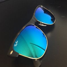 Blue Mirrored RayBan Clubmaster Iconic Clubmasters with blue mirrored lenses. Looks great with anything and makes you stand out. Tortoise finish Ray-Ban Accessories Sunglasses