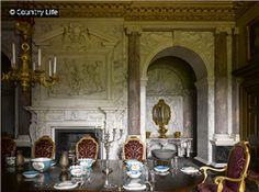 The Marble Parlour at Houghton Hall Norfolk, England. The chimneypiece is palladian style with classical ornaments dedicated to Baccus, the god of wine.