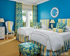 Bright color unfurls in a high-octane tropical flair in this blue bedroom! - Photo: Robert Brantley / Design: Gary McBournie