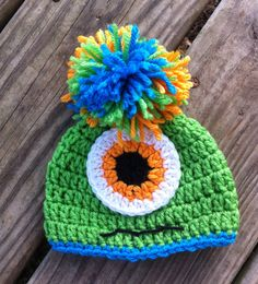 How adorable for your baby or toddler boy or girl! This MONSTER crochet beanie hat features a big front eye, cute smile & pom-pom on top! I crochet