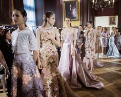 Models prepare backstage during the Georges Hobeika Haute Couture Fall/Winter 2016-2017 show as part of Paris Fashion Week on at Ecole de Medecine on July 4, 2016 in Paris, France.
