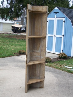 Cournershelf from an old door. The shelves are from old barn siding Barn Wood Crafts, Old Barn Wood, Reclaimed Wood Projects, Barn Board Projects, Old Door Projects, Craft Shelves, Dark Wood Bed, Barn Siding, Into The Woods